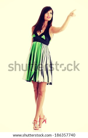 Sexy woman in summer dress, isolated on white background  - stock photo