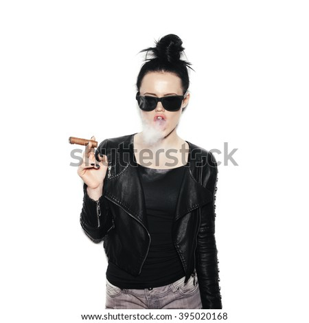 Sexy woman in sunglasses blowing smoke from a cigar. Swag style girl on White background, not isolated