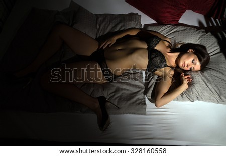 sexy woman in underwear lying in bed / sexy woman - stock photo