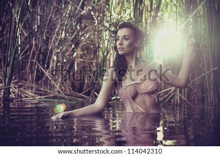 Sexy woman in water - stock photo