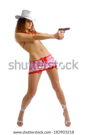 Sexy woman is aiming a pistol with both hands. She is wearing a white stetson, a short skirt and a top decorated red bowls.  - stock photo