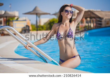 sexy woman is relaxing in the pool