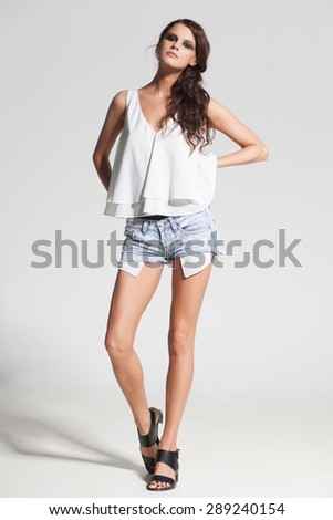 sexy woman model dressed casual, posing in the studio - stock photo