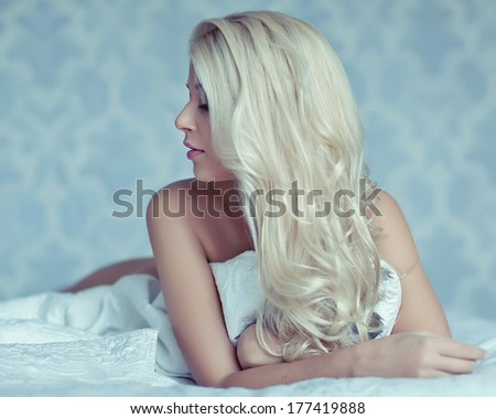 Sexy woman on the bed - stock photo