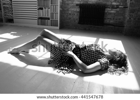 sexy woman on the floor in provocative pose  - stock photo