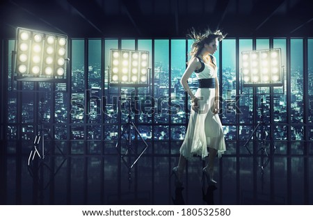 Sexy woman over night city background - stock photo