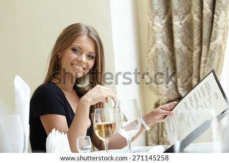 Sexy woman posing with menu at lunch time - stock photo