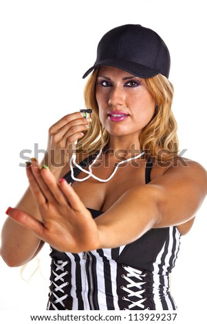 Sexy woman referee blows whistle signaling stop isolated on white.