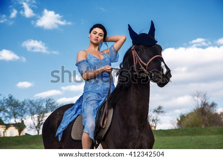 Sexy woman riding a horse over sunset on background. - stock photo