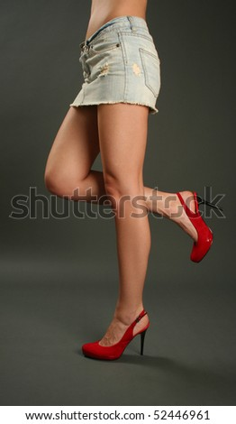 sexy woman's legs with red high heel shoes