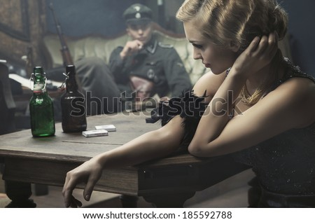 Sexy woman seduce a soldier - stock photo