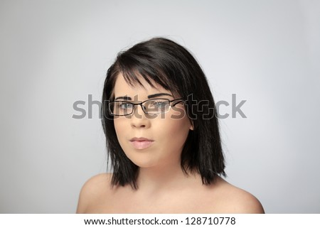 sexy woman shot in the studio wearing broken eye wear