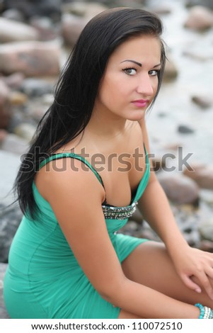 sexy woman sitting by the sea