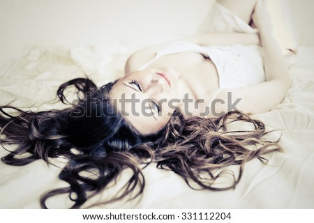 sexy woman sleep on bed in lingerie  - stock photo