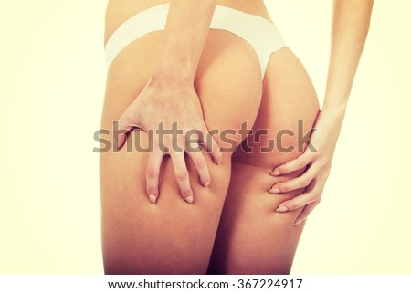 Sexy woman touching her buttocks.