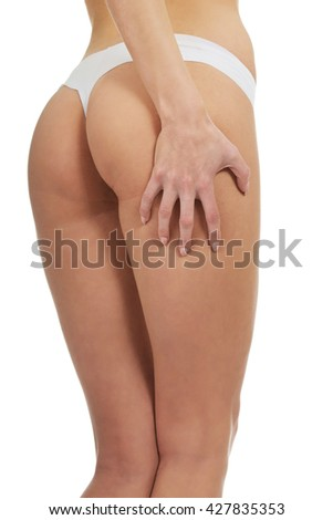 Sexy woman touching her thigh.