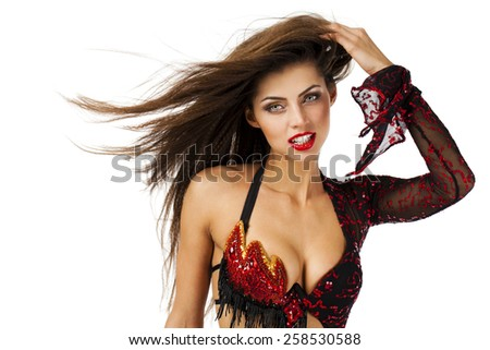 Sexy Woman traditional Spanish Flamenco dancer dancing in a red dress  - stock photo