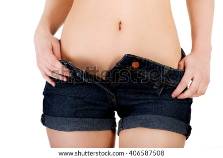 Sexy woman undressing her shorts. - stock photo