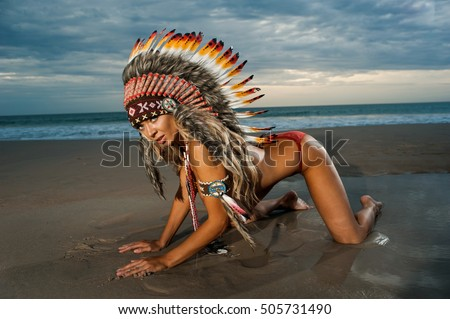 Sexy woman wearing American Indian war bonnet