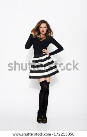 Sexy woman wearing mini skirt and stockings  - stock photo
