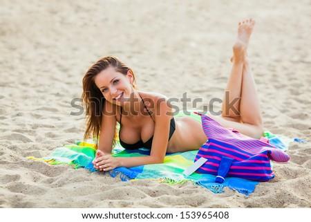 sexy woman wearing pink bikini walking on beach, full length portrait - stock photo