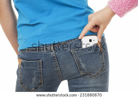Sexy woman with a cell phone in her back pocket and a thief in trying to steal it on a white background - stock photo