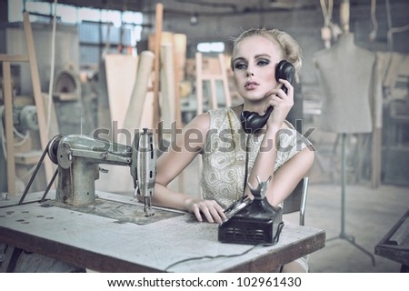 Sexy woman with a phone - stock photo