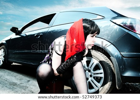 Sexy woman with baggage near to car