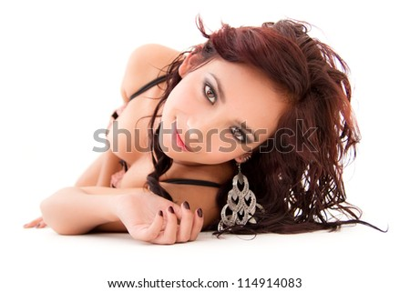 Sexy woman with beautiful face posing on the floor