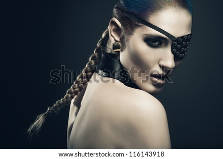 sexy woman with black eye-patch - stock photo