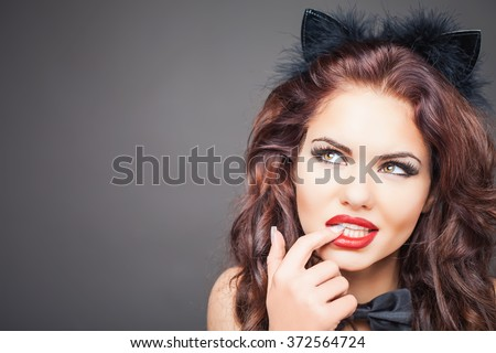 Sexy woman with cat carnival mask. Ears. Role-playing games. Games for Adults. Fashion. Venetian carnival. Sex shop. Hot babe. Party. Night background  - stock photo