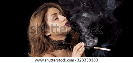 Sexy woman with cigarette holder smoking letterbox