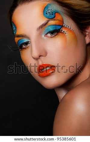 sexy woman with creative face art - stock photo