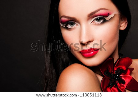 sexy woman with creative face art on black background