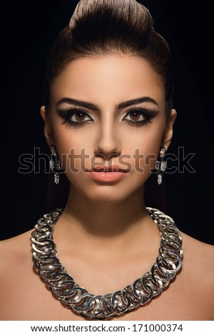 Sexy woman with earrings and beautiful necklace