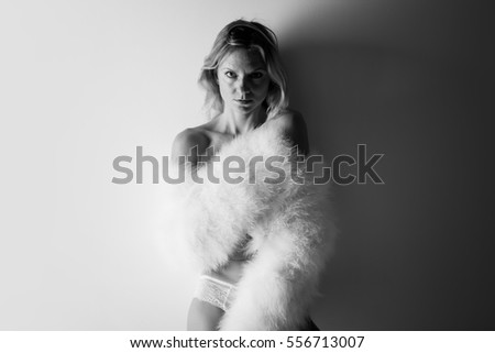 Sexy woman with feather coat