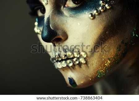 Sexy woman with flowers face in halloween Masquerade looking at camera