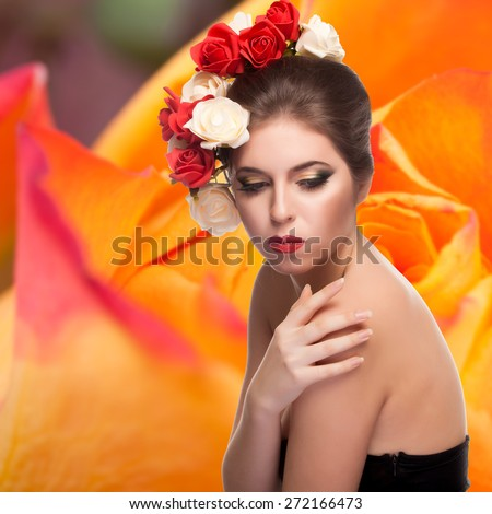 Sexy woman with flowers in her head on tulip background. Studio shooting. Beauty and fashion. Spring theme
