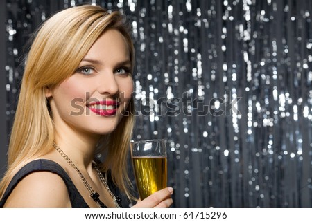 Sexy woman with glass of champagne - stock photo
