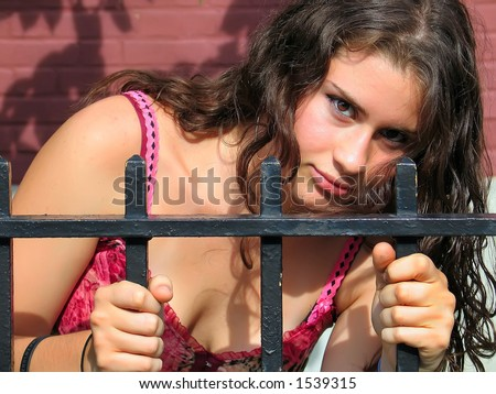 Sexy Woman with graffiti and fence - stock photo