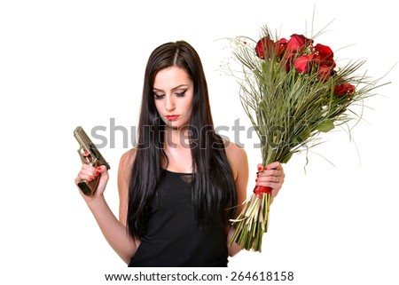 sexy woman with gun and flower - stock photo