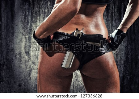 sexy woman with hand gun - stock photo