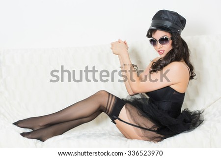 sexy woman with handcuffs in fashion glasses - stock photo