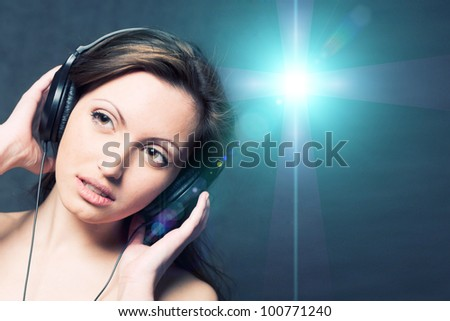 Sexy woman with headphones listening to music - stock photo