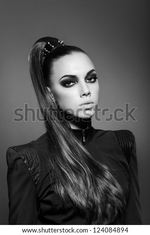 sexy woman with long hair, make-up and smokey eyes in black and white - stock photo
