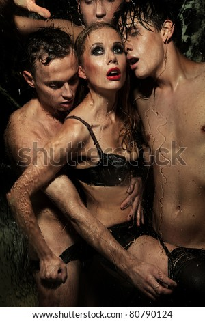 Sexy woman with men - stock photo