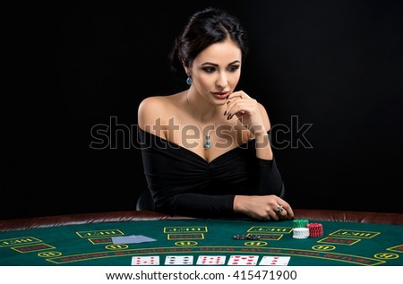 sexy woman with poker cards and chips