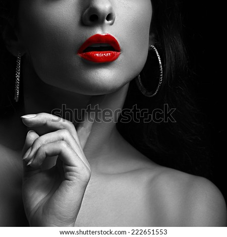 Sexy woman with red lips black and white portrait closeup