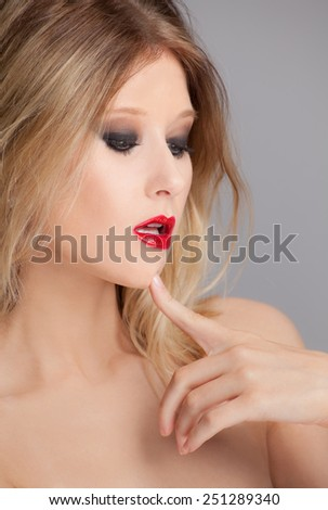 Sexy Woman With Red Lipstick and Smokey Eye Makeup