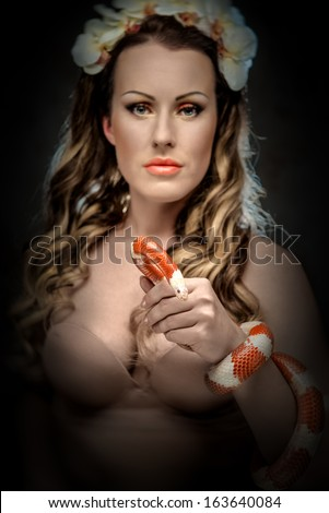 Sexy woman with snake - stock photo
